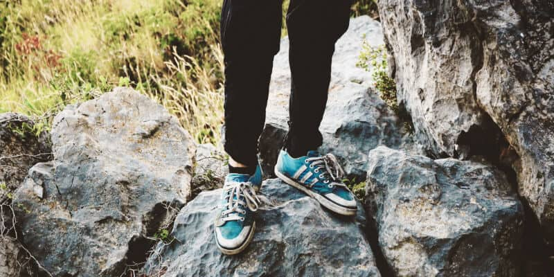 Feet with climbing shoes on