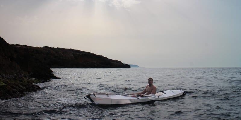 Man in a white kayak